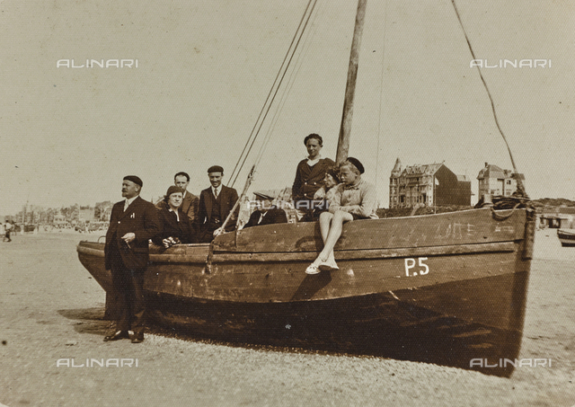 Group portrait with boat