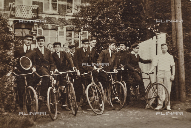 Portrait of a group of students of a college with bicycles