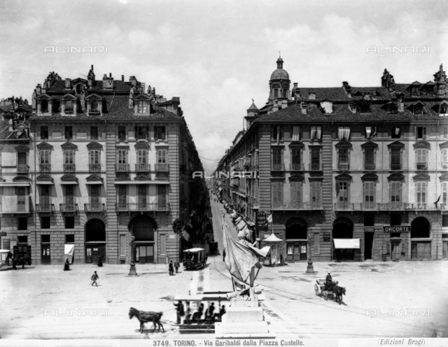 Busy view of Piazza Castello, from which part of Via Garibaldi is visible, Turin.