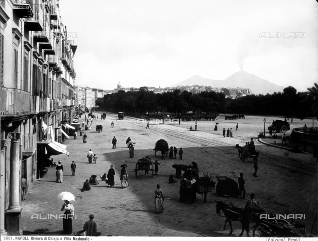 View with people of the Chiaia Riviera and of part of the Villa Nazionale Park in Naples.
