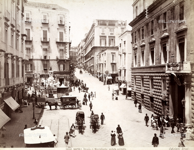 View of Monteoliveto Street with people in Naples.