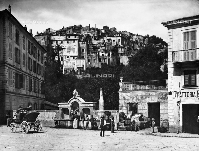 A carriage and a group of people in Piazza Colombo in Sanremo, a town in the province of Imperia