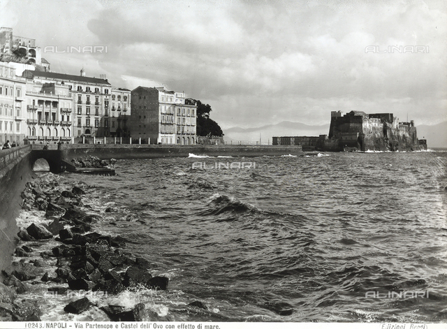 Moderate sea at the shore of Via Partenope in Naples. In the background, Castel dell'Ovo