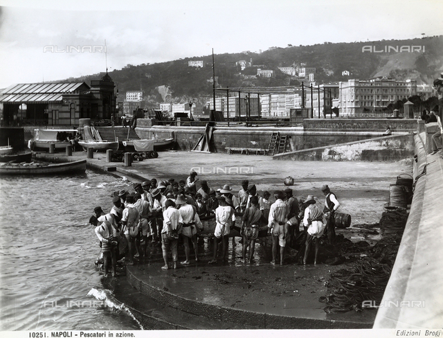 Group of fishermen on a pier in Naples