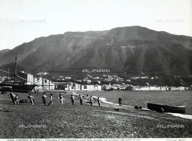 View of Castellammare di Stabia, near Naples. In the foreground, fishermen on the beach haul in the nets.