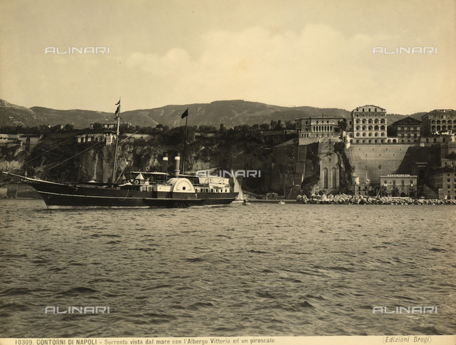 A steamship in the sea of Sorrento, near Naples. On the right, the Vittoria Hotel with the funicular.
