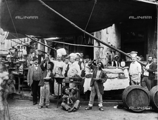 Neapolitan pasta vender with a group of youth and cooks.
