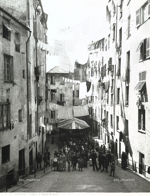 View of an alley with people in Genoa.