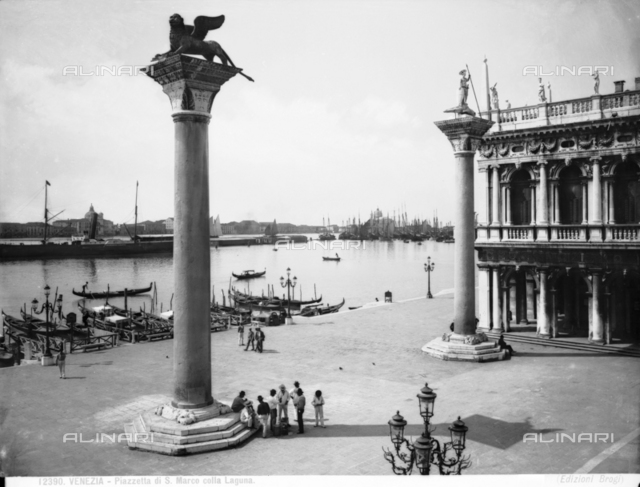 View of the lagoon from Piazzetta, S. Marco, Venice. Two monolithic columns topped by a statue of the Lion of St. Mark and St. Theodore.
