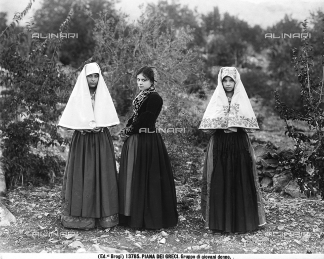 Three young women in traditional dress photographed at Piana dei Greci, today's Piana degli Albanesi, in the province of Palermo