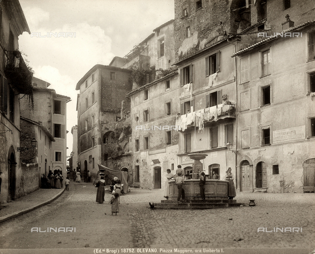 View of Piazza Umberto I (Umberto I Square) with people in Olevano Romano.