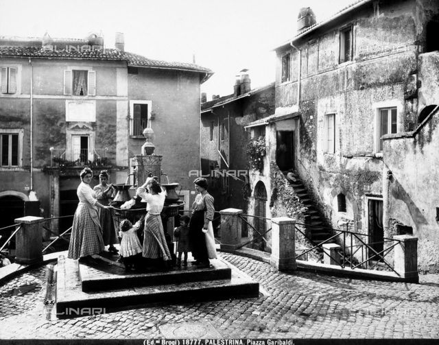 View of the fountain in Piazza Garibaldi in Palestrina, around the fountain, a group of women is found