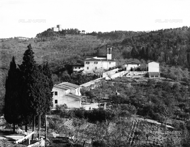 The Poggio Church and Castle, surrounded by the hills of Fiesole. The Vincigliata Castle stands on the top of the knoll.