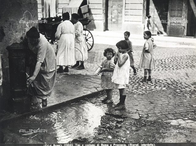 Women with their daughters walking to a fountain of Rome to draw some women.