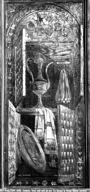 Trompe-l'oeil of a sacristy cabinet, inlaid stall, Choir, Fra' Giovanni da Verona, Cathedral, Siena.