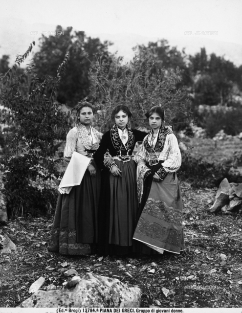Three girls photographed in traditional dress in Piana dei Greci, now Piana degli Albanesi, in Sicily.