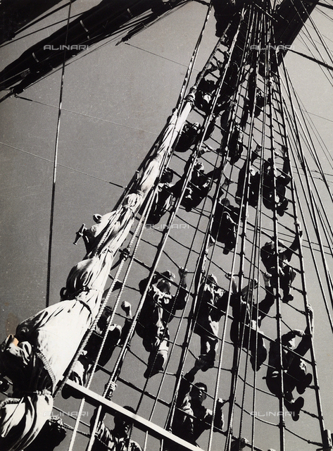 "School ship ""Amerigo Vespucci"" of the Italian Royal Navy: sailors climbing rope"