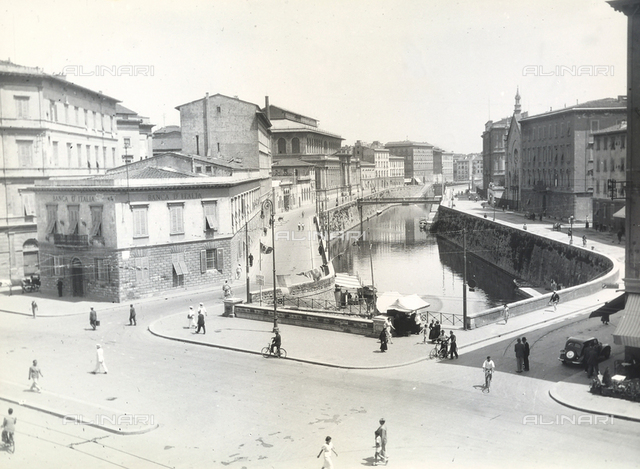 View with people of Livorno with a bridge over a canal.