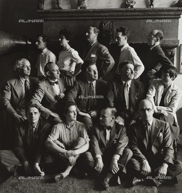 The surrealists in the autumn of 1942: in the last row Jimmy Ernst, Peggy Guggenheim, John Ferren, Marcel Duchamp and Piet Mondrian, in the center row Max Ernst, Amédée Ozenfant, André Breton, Fernand Léger and Berenice Abbott, Stanley William Hayter, Leonora Carrington. Photography by Hermann Landshoff in the Münchner Stadtmuseum in Munich
