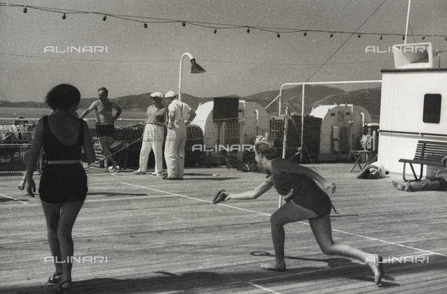 "Album ""At the edge of Oceania 28 July to 10 August 1935"": Tourists photographed whilst playing tennis on board the cruise ship ""Oceania"""
