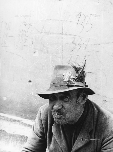 Portrait of an elderly man with hat