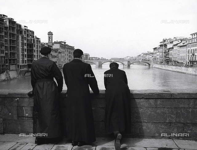 Priests on a bridge in Florence