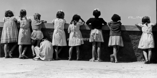 Group of children leaning against a parapet