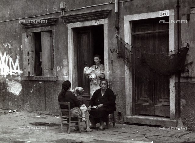 Women in a conversation outside a house, Chioggia