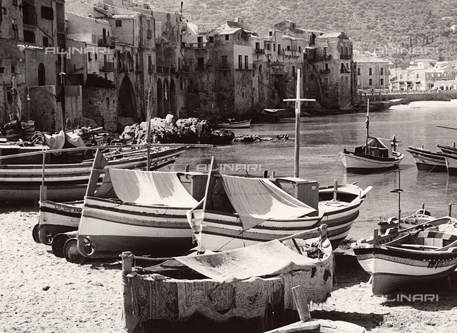 Boats along the shore in Cefalù
