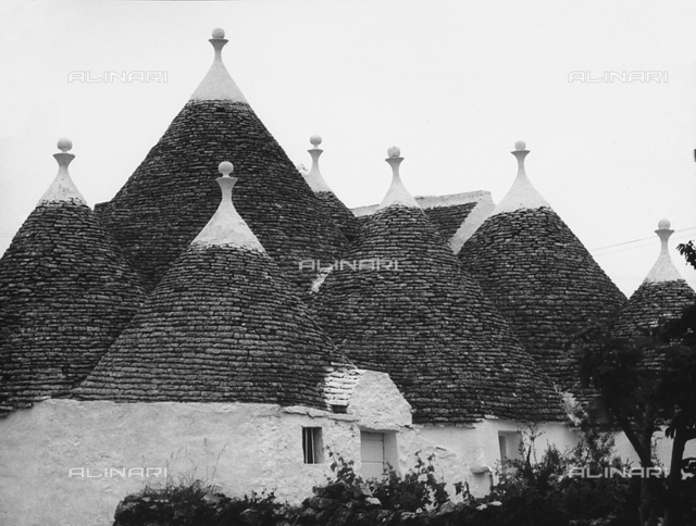 """Alberobello"". View of some trulli."