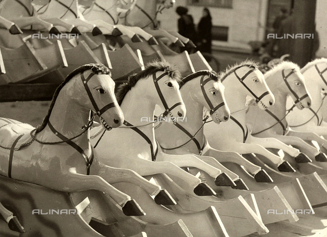 """The Cavalcade"". Rocking horses displayed outdoors."