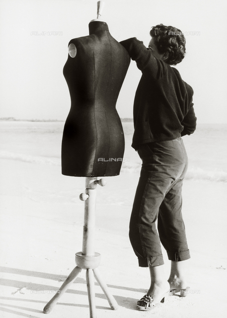 Woman and manikin on the beach