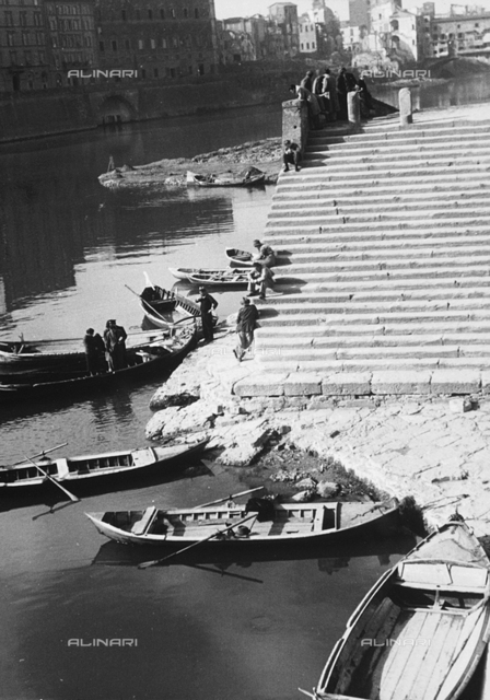 Boats on the river Arno, Florence