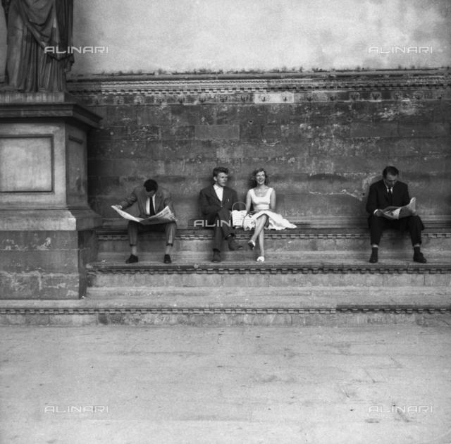 Tourists in the Loggia della Signoria in Florence