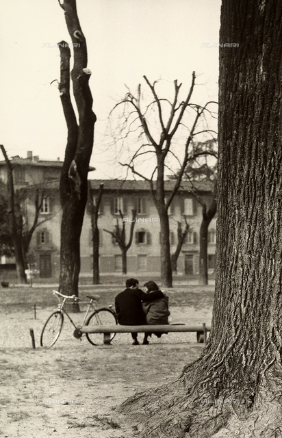 A young couple sitting on a bench in Piazza Donatello in Florence.