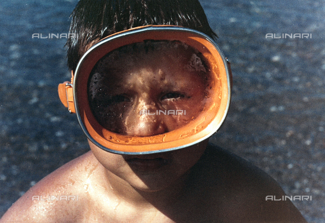 Portrait of a child with a diving mask