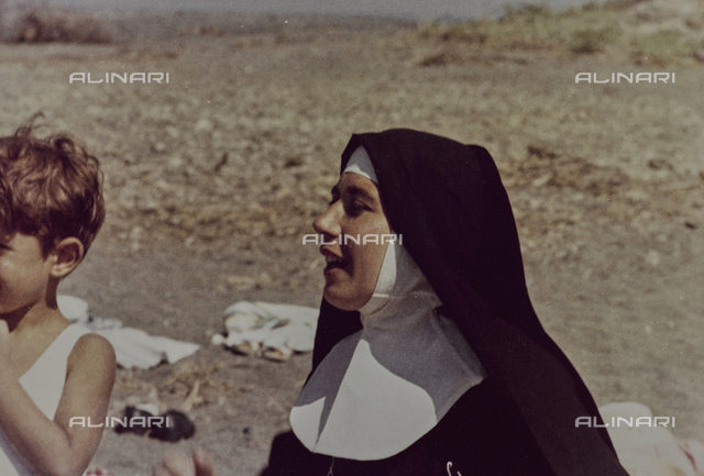 A nun at the beach