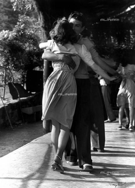 """Appassionatamente"" A man and a woman dancing in a close embrace"