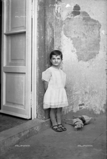 Little girl with a toy horse, Tuscany