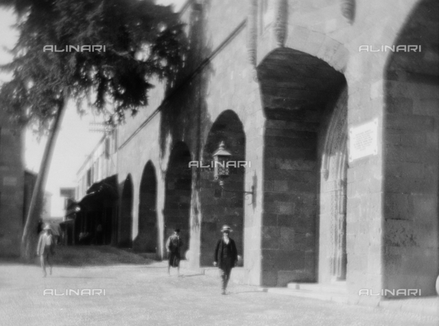 Street with arched building; Photo studio