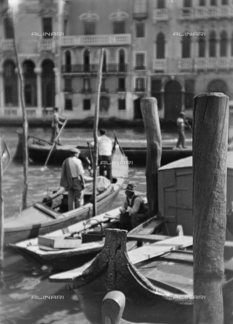 Boats for freight and gondola on the Grand Canal, Venice; Photo studio