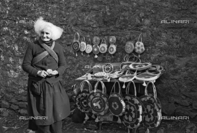 Old woman handbags and straw handbags, Tuscany