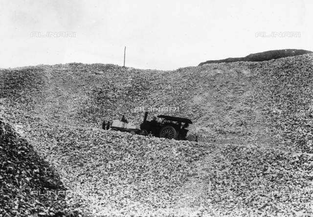 """A """"ciabattona"""" (shuffler), or rather the steam vehicle that transported the blocks of marble from the quarries to the valley, along a road in the Apuan Alps, Tuscany"""