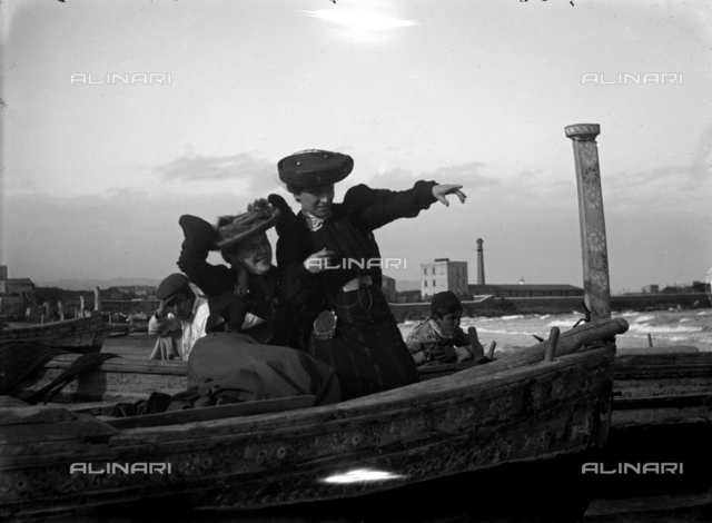 Pair of ladies on a boat in the beach of Catania