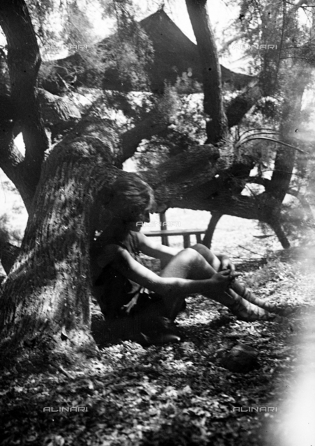 Portrait of a woman under a tree