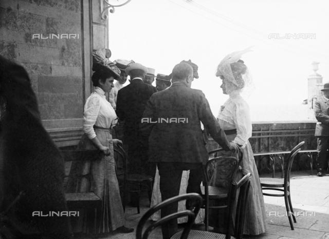 Group of tourists on a terrace, lake Trasimeno