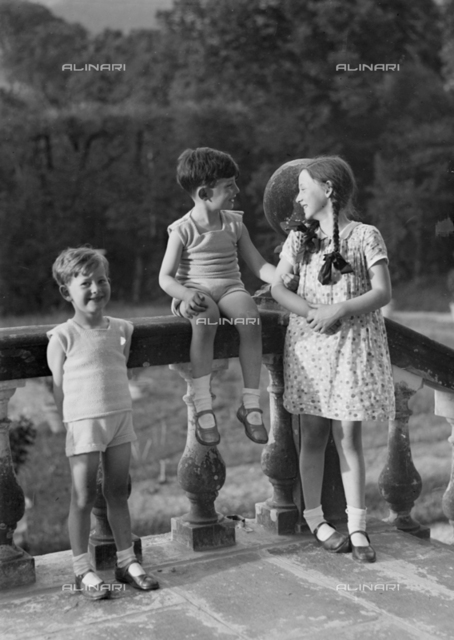 Group of children in front of a balustrade