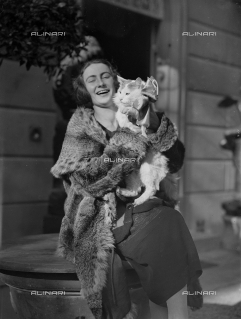 Portrait of a woman with a cat