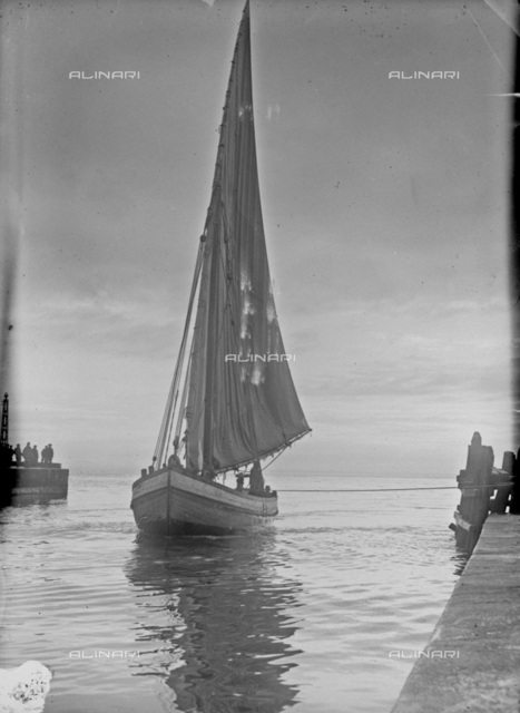 A sailboat docked at the pier, Viareggio