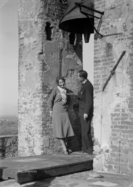 Portrait of couple under a Tower-bell